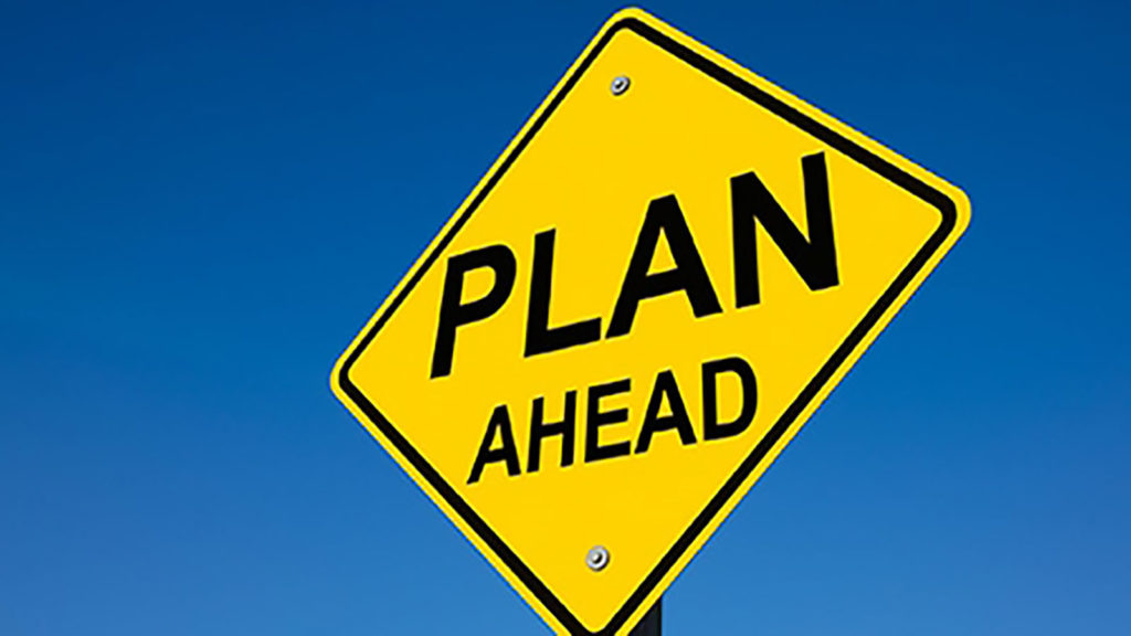 Road sign with 'Plan Ahead'.